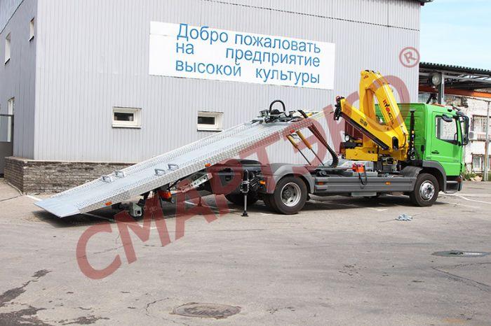 Эвакуатор со сдвижной платформой Mercedes Benz Atego с КМУ HYVA