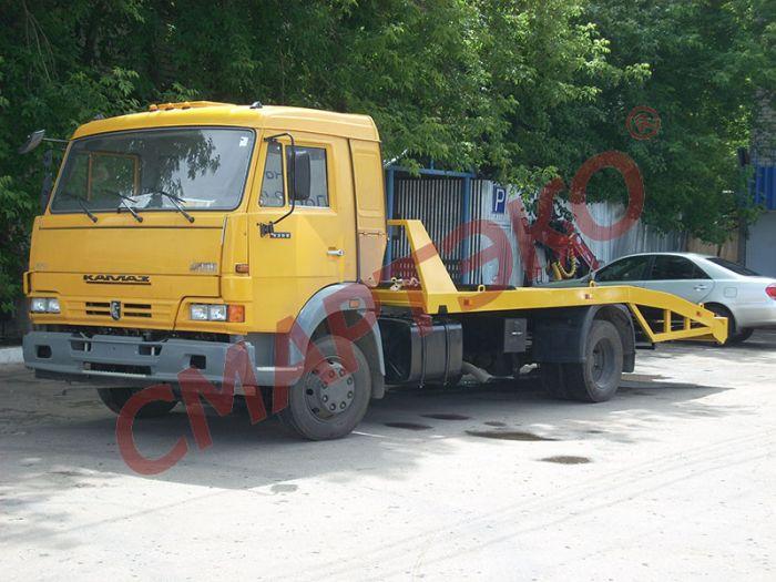 Эвакуатор с ломаной платформой КАМАЗ-4308